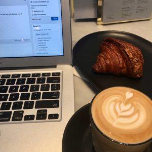 Computer, coffee, croissant