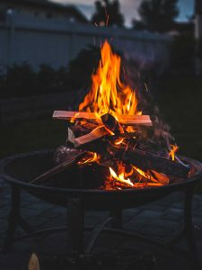 Logs burning in a fire pit